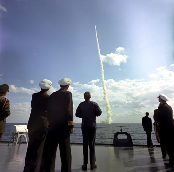 "KN-C30560 16NOV1963 President John F. Kennedy observes the firing of a Polaris missile by the Submarine Andrew Jackson aboard the U.S.S. Observation Island off the coast of Florida. Please credit ""Robert Knudsen, White House/John F. Kennedy Presidential Library and Museum, Boston"""